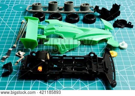 Mini 4wd Toy Cara Awaiting To Be Assemble On Cutting Mat. Popular Toy Car During 90's.