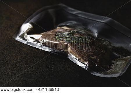 Vacuum Packed Meat, Steak. Sous-vide, New Technology Cuisine.