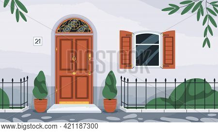 Front Wooden Door With Knocker. Home Exterior With Arch Doorway, Porch, Window With Shutters, Potted