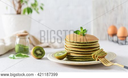 Green Pancakes With Matcha Tea. Ideas And Recipes For Healthy Breakfast With Superfood Ingredients.