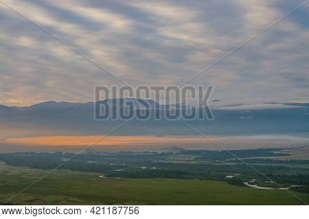 Scenic Alpine Landscape With Vast Plateau With Mountain River And Forest In Sunlight On Background O