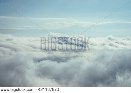Wonderful Minimalist Landscape With Mountain Top Above Dense Low Clouds. Mountain Vertex Floats In T