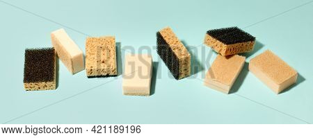 Set Of Neutral Beige Clean Sponges For Home Cleaning On Blue Background. Banner For Your Site, Conce
