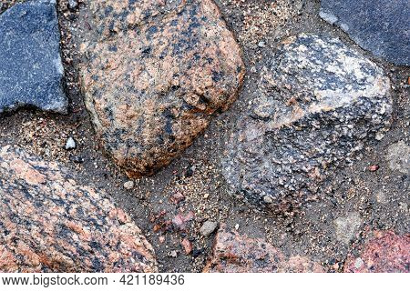 Fragment Of Cobblestone Pavement, Large Round Stones Close Up, Background And Texture