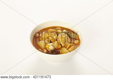 A Chicken Massaman Curry In White Bowl Isoated On White Background. Massaman Curry Is Thai Cuisine D