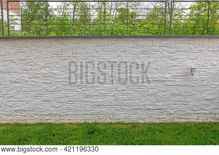 Tall White Wall In Garden With Grass