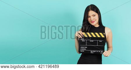 Clapper Board Or Movie Clapperboard In Teenage Girl Or Woman Hand With Black And Yellow Color.it Use