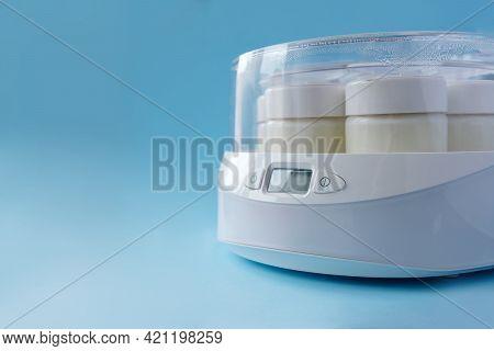Fermented Yogurt In Yogurt Machine On Blue Background