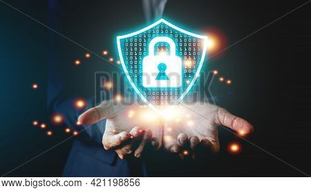 Businessman Holding The Master Lock Icon Shield Protect, Protection Network Security Data Concept.