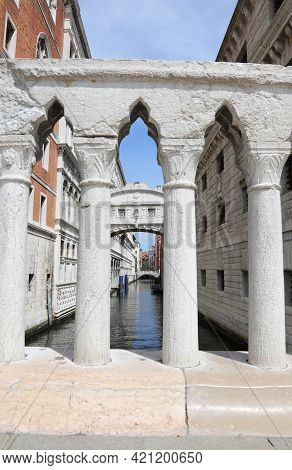 Stone Balustrade And In The Background The Famous Bridge Of Sighs In Venice In Italy And The Navigab