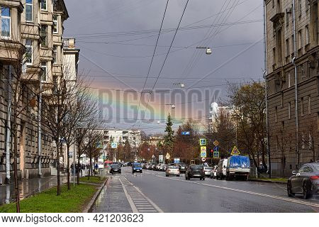 Saint Petersburg, Russia - May 02, 2021: Rainbow In The Sky Over A Wet City Street After Rain In Sai