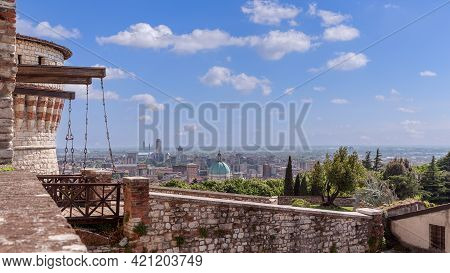 Medieval Drawbridge At The Entrance To The Castle And A View Of The City Center Of Brescia. Lombardy