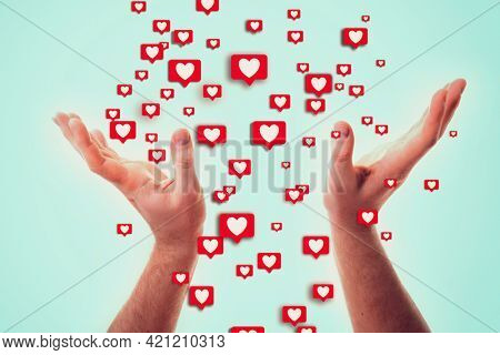 A man grabs with his hand the likes on social networks, successful blogging and youth culture concept. Fame and universal acceptance on the Internet