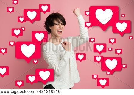 Likes. Universal love, acceptance, popularity and success in social networks. Fake feelings. Beautiful young woman blogger happy and excited expressing winning gesture