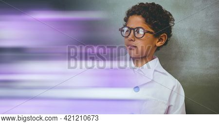 Composition of schoolboy with protective glasses in school laboratory with purple motion blur. science, learning and knowledge concept digitally generated image.