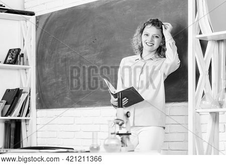 Girl Adorable Teacher In Classroom. Educational Program For Primary School. Educational Process Conc