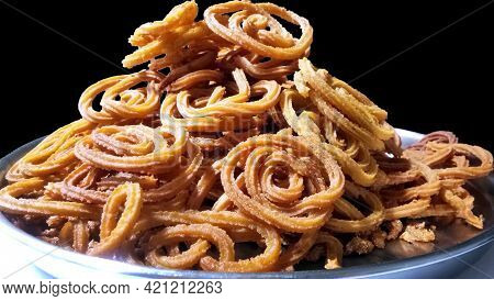 Indian Traditional Snack Chakli, A Spiral Shaped Crisp Deep Fried Snack, It Is Known As Chakali, Mur