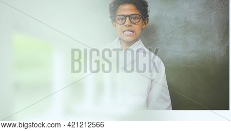 Composition of schoolboy in glasses in school laboratory with motion blur. science, learning and knowledge concept digitally generated image.