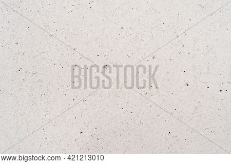 Cardboard Sheet Of Paper Close Up. White Craft Paper Texture Background. Top View Cardboard Use For