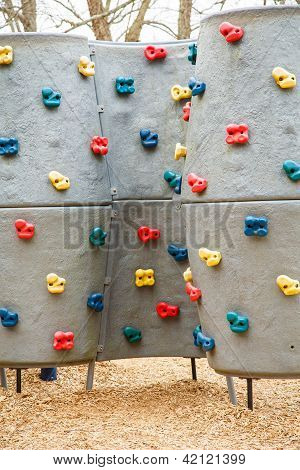 Kids Climbing Wall With Colorful Handholds