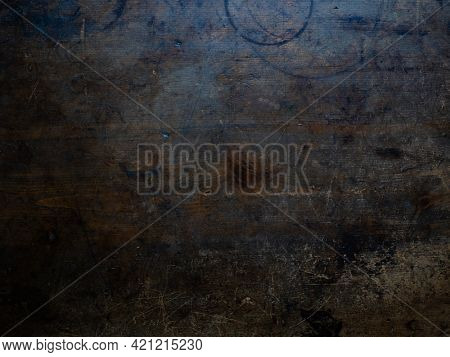 Weathered and distressed wooden board background of an old dark wooden table top. old wood background.