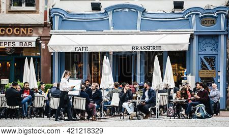 Strasbourg, France - May 19, 2021: People Eating Drinking At The Terrace Of Hotel On Pedestrian Dist
