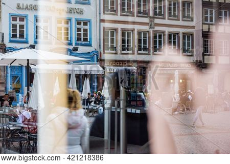 Strasbourg, France - May 19, 2021: Reflection Of People Eating Drinking At The Terrace In Place De L