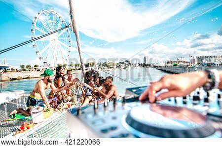 Millenial Friends Having Fun Toasting Wine At Sail Boat Party - Wanderlust Travel Concept With Multi