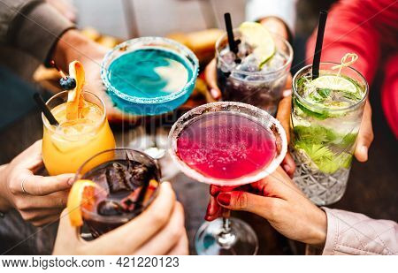 People Hands Toasting Multicolored Fancy Drinks - Young Friends Having Fun Together Drinking Cocktai