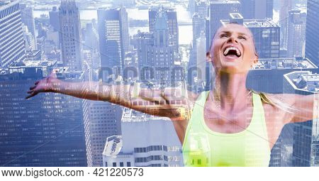 Composition of happy, healthy caucasian woman with arms outstretched over modern city background. global communication, health and technology concept, digitally generated image.
