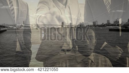 Composition of businessman pointing at camera over cityscape. global business and finance concept digitally generated image.