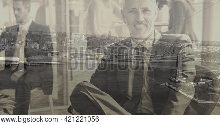 Composition of smiling caucasian businessman over cityscape. global business and finance concept digitally generated image.