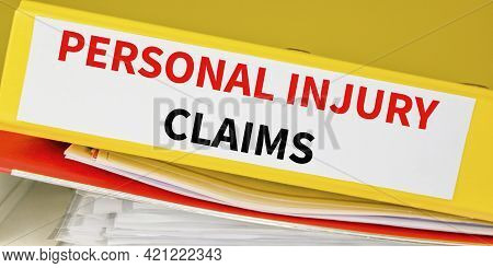 Personal Injury Claims Binder In The Office. Business And Law Concept.