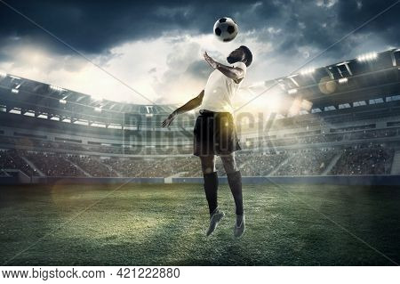 Professional Male Football, Soccer Player On Stadium Background. African Fit Athlete Practicing, Pla