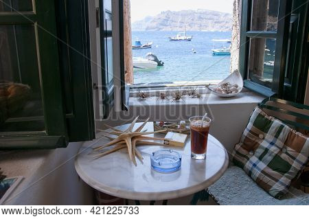 A View From The Sea Window In Amoudi, The Cozy Fisherman's House With Starfish And A Drink On The Ta
