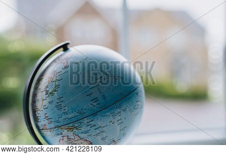 World Globe Ball With Blurry House Background, Blue World Map  With Copy Space For Text,world Enviro