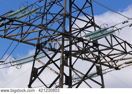 Power Line Construction Of Cable Supports And Insulators. High Voltage Power Line On Blue Sky Backgr