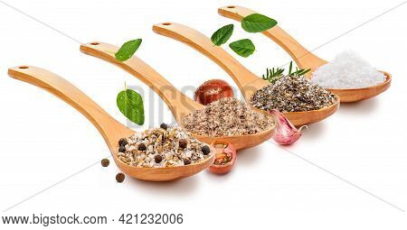 Variety Of Salt (salts) With Various Spices (tomato, Garlic, Oregano, Rosemary, Black Pepper) In Woo