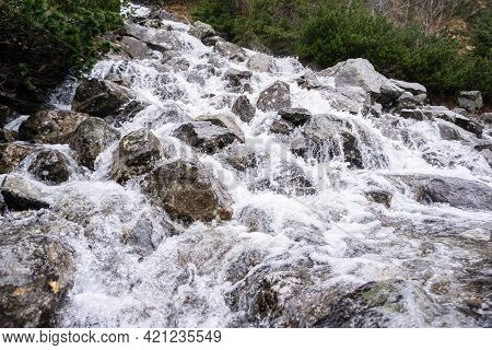 Mountain River Swiftly Descend Over The Stones