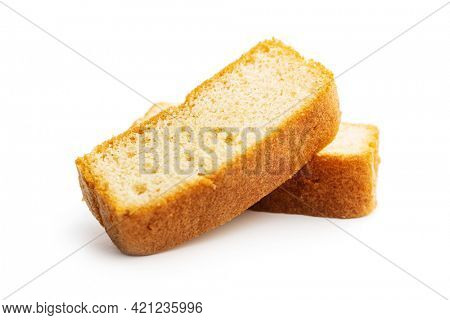 Sliced sponge dessert. Sweet sponge cake isolated on white background.