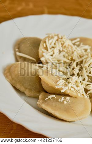 Tasty Slovak Food Pirohy Filled Dumplings With Plum Jam With Grated Tvrdy Tvaroh Quark On White Plat