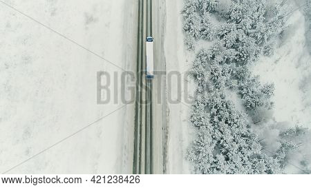 Truck Drive Along The Road Through The Winter Forest. Scene. Aerial View On Car Driving In Winter, R