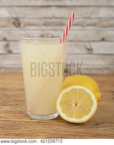 Sicilian Lemon Juice In A Glass With Fruits Over Wooden Table.