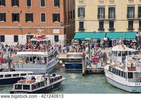Venice, Italy - June 13, 2016:  Boats And Tourists Fill The Harbor Near Piazza San Marco, Often Know