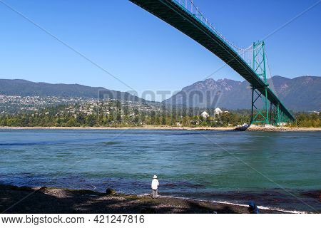 View Of Lions Gate Bridge From Stanley Park In Vancouver, British Columbia, Canada