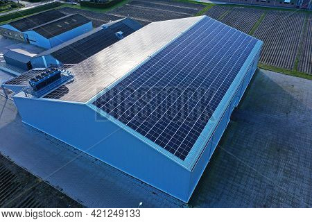 Roof Of A Commercial Building Full Of Solar Panels. The New Green Energy Supplier