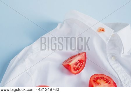 A Drop Of Spilled Tomato Sauce On The Collar Of A White Shirt. Top View