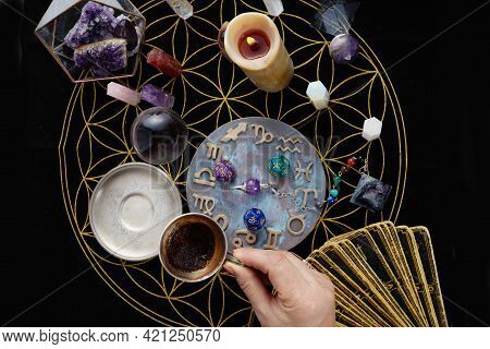 Fortune Telling Table With Tarot Cards And Esoteric Objects. Fortune-teller Guessing From Coffee Gro