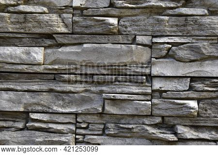 The Wall Of The House Is Masonry Of Yellow Stone