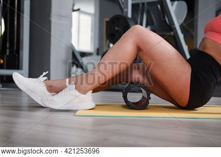 Cropped Shot Of A Sportsowman Using Foam Roller To Relax Hamstrings At The Gym